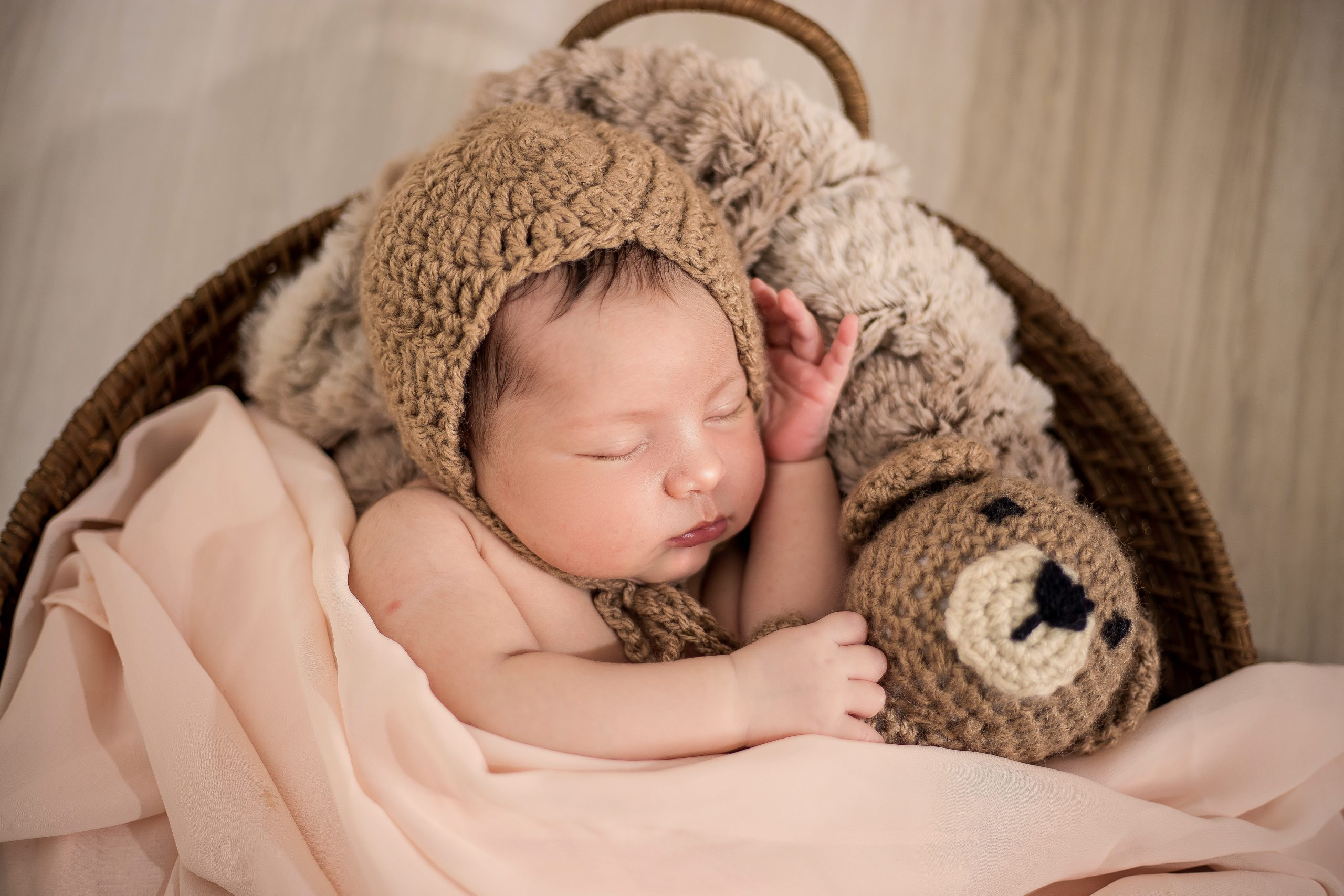 When can a baby sleep with a blanket?